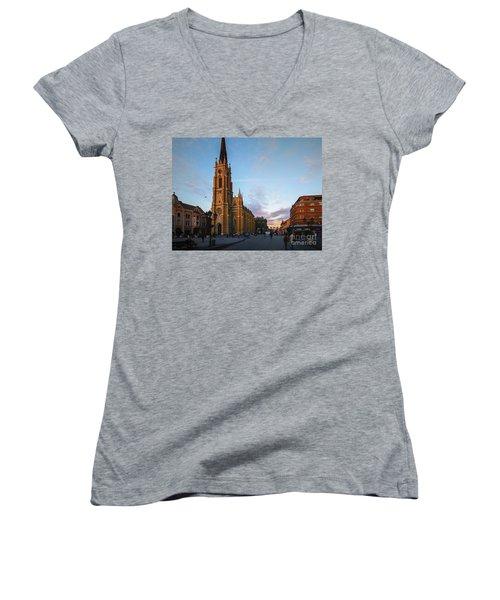 Women's V-Neck T-Shirt (Junior Cut) featuring the photograph The Name Of Mary Church At Dusk Novi Sad by Jivko Nakev