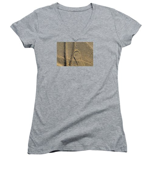 Women's V-Neck T-Shirt (Junior Cut) featuring the photograph Tire And Sneaker Tracks by Lyle Crump