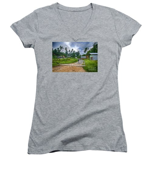 Women's V-Neck T-Shirt (Junior Cut) featuring the photograph Village Scene by Charuhas Images