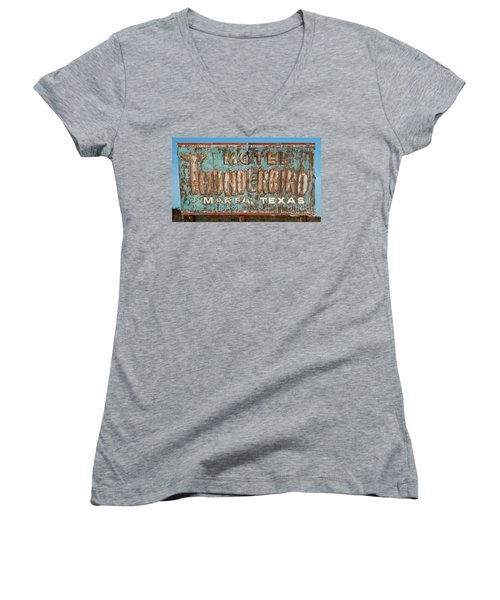 Women's V-Neck T-Shirt (Junior Cut) featuring the photograph Vintage Weathered Thunderbird Motel Sign Marfa Texas by John Stephens