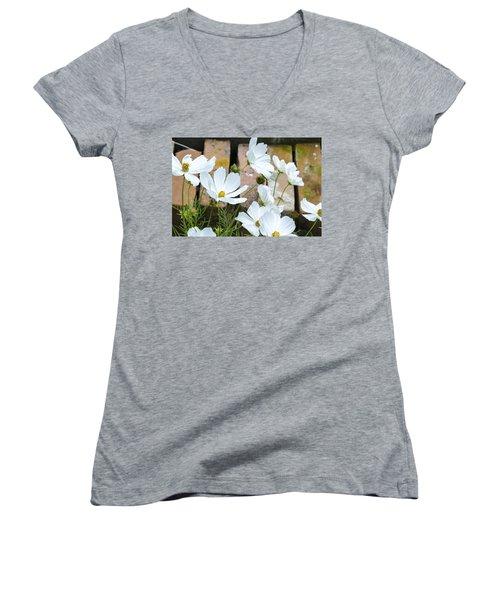 White Flowers Against Bricks Women's V-Neck
