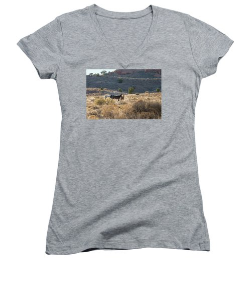 Women's V-Neck T-Shirt (Junior Cut) featuring the photograph Wild Horses In Monument Valley by Jon Glaser