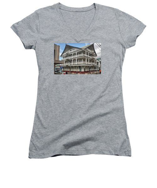 Wooden House In Colonial Style In Downtown Suriname Women's V-Neck T-Shirt (Junior Cut) by Patricia Hofmeester