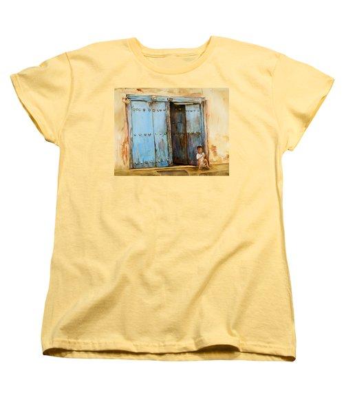 Child Sitting In Old Zanzibar Doorway Women's T-Shirt (Standard Cut) by Sher Nasser
