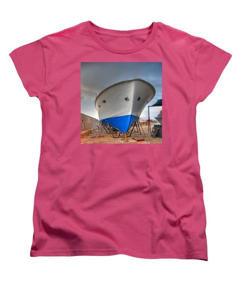 Women's T-Shirt (Standard Cut) featuring the photograph a resting boat in Jaffa port by Ron Shoshani