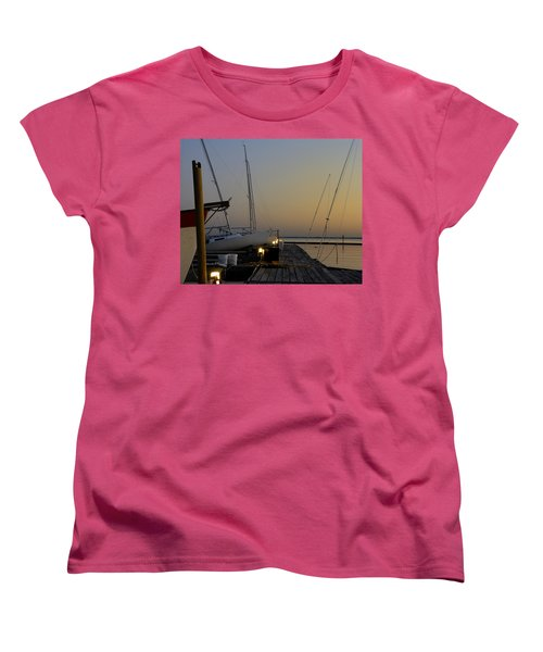 Women's T-Shirt (Standard Cut) featuring the photograph Boats Moored To Pier At Sunset by Charles Beeler