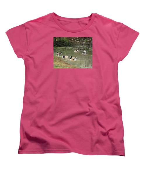 Women's T-Shirt (Standard Cut) featuring the photograph Canadian Geese Feeding In Backwaters by William Tanneberger