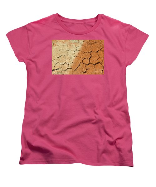 Women's T-Shirt (Standard Cut) featuring the photograph Cracked Soil In Red Shades by Les Palenik