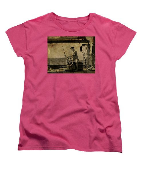 Women's T-Shirt (Standard Cut) featuring the photograph old sailor A vintage processed photo of a sailor sitted behind the rudder in Mediterranean sailing by Pedro Cardona