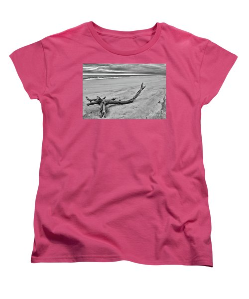 Women's T-Shirt (Standard Cut) featuring the photograph Driftwood On The Beach In Black And White by Paul Ward