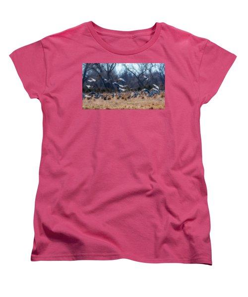 Sandhill Crane Taking Flight Women's T-Shirt (Standard Cut) by Edward Peterson