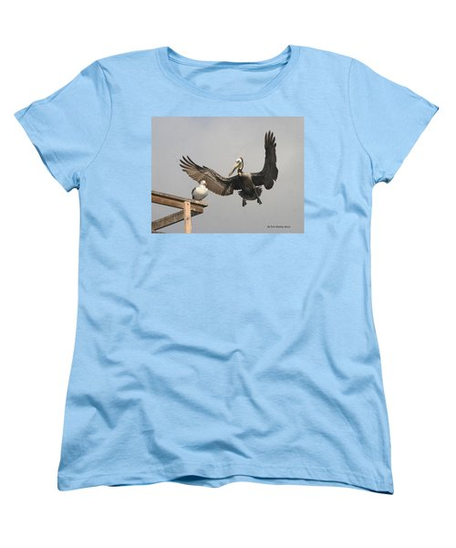 Women's T-Shirt (Standard Cut) featuring the photograph Pelican Wins Sea Gull Looses by Tom Janca