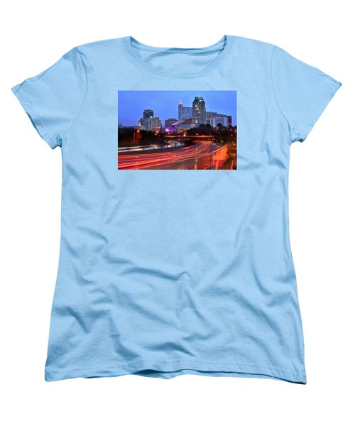 Women's T-Shirt (Standard Cut) featuring the photograph Raleigh Skyline At Dusk Evening Color Evening Panorama North Carolina Nc by Jon Holiday