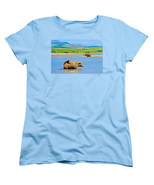 Six-month-old Cub Riding On Mom's Back To Cross Moraine River In Katmai National Preserve-alaska Women's T-Shirt (Standard Cut) by Ruth Hager