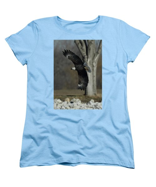 Women's T-Shirt (Standard Cut) featuring the photograph Eagle Soaring By Tree by Coby Cooper