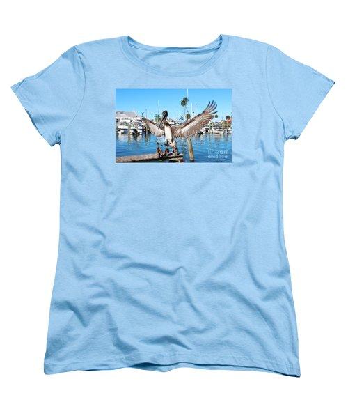 Pelican Flying In Women's T-Shirt (Standard Cut) by Megan Dirsa-DuBois