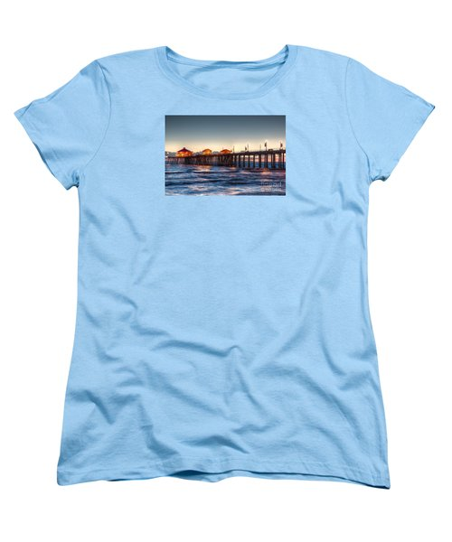 Women's T-Shirt (Standard Cut) featuring the photograph Ruby's Surf City Diner At Twilight - Huntington Beach Pier by Jim Carrell
