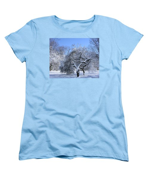 Women's T-Shirt (Standard Cut) featuring the photograph Snow-covered Sunlit Apple Trees by Byron Varvarigos