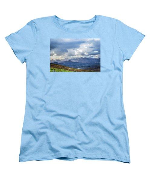 Women's T-Shirt (Standard Cut) featuring the photograph Sun Rays Piercing Through The Clouds Touching The Irish Landscap by Semmick Photo