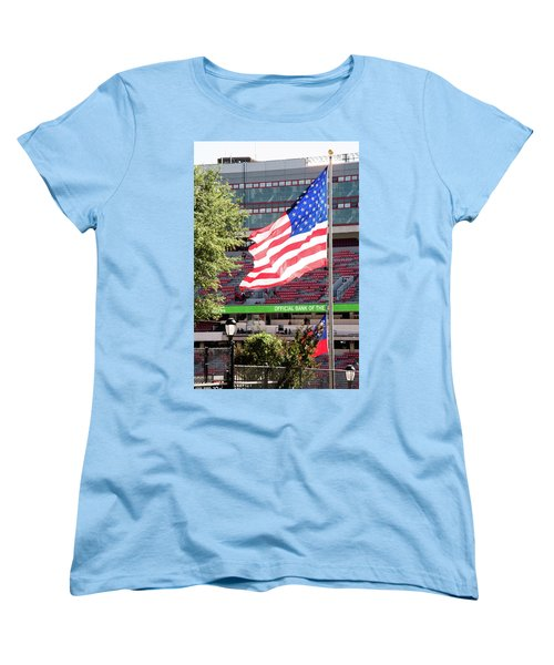 Women's T-Shirt (Standard Cut) featuring the photograph The Flag Flying High Over Sanford Stadium by Parker Cunningham