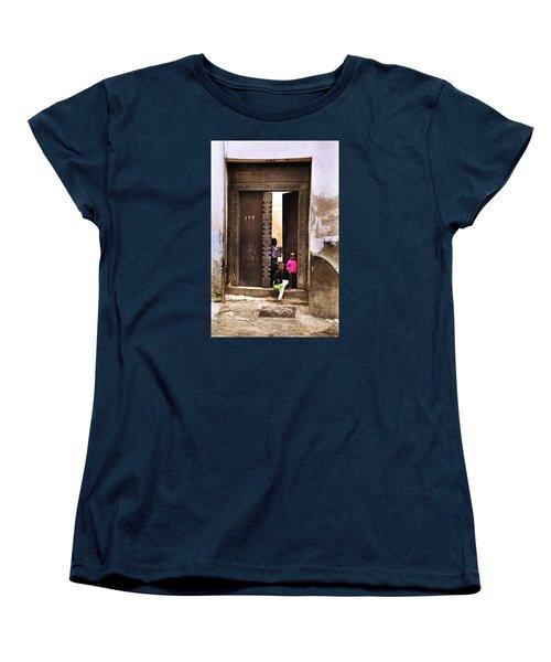 Women's T-Shirt (Standard Cut) featuring the photograph Kids Playing Zanzibar Unguja Doorway by Amyn Nasser