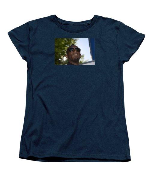 Women's T-Shirt (Standard Cut) featuring the photograph Usain Bolt - The Legend 1 by Teo SITCHET-KANDA