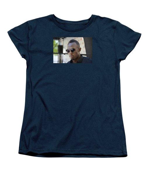 Women's T-Shirt (Standard Cut) featuring the photograph Usain Bolt - The Legend 3 by Teo SITCHET-KANDA