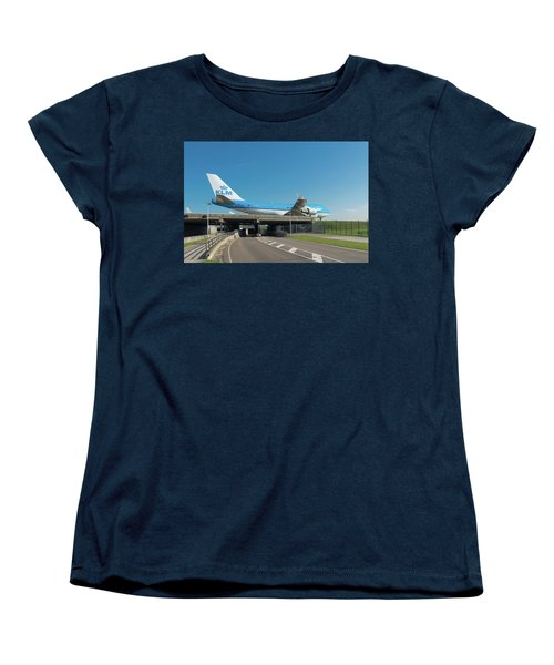 Airplane Over Highway Women's T-Shirt (Standard Cut) by Hans Engbers