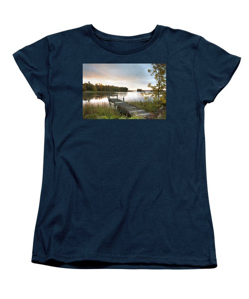 A Dock On A Lake At Sunrise Near Wawa Women's T-Shirt (Standard Cut) by Susan Dykstra