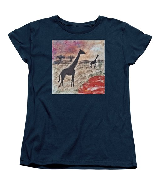 Women's T-Shirt (Standard Cut) featuring the painting African Landscape Giraffe And Banya Tree At Watering Hole With Mountain And Sunset Grasses Shrubs Sa by MendyZ