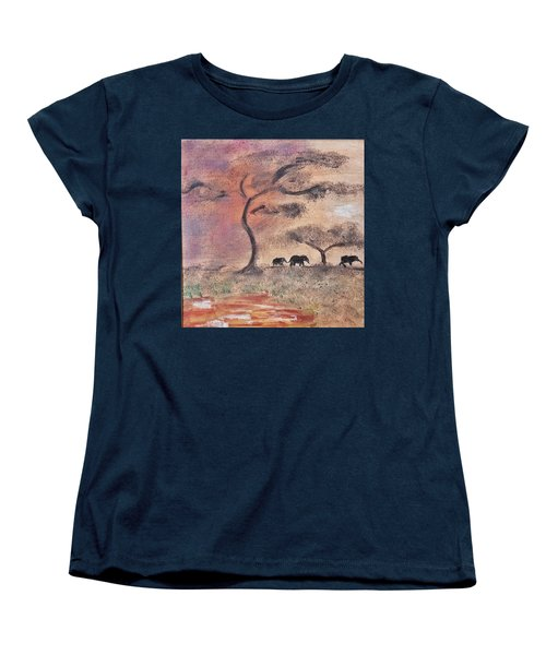 Women's T-Shirt (Standard Cut) featuring the painting African Landscape Three Elephants And Banya Tree At Watering Hole With Mountain And Sunset Grasses S by MendyZ