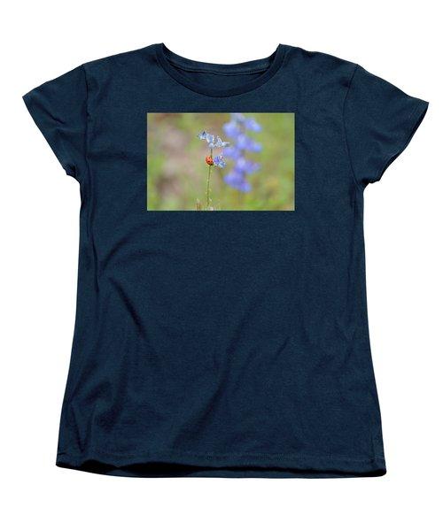 Women's T-Shirt (Standard Cut) featuring the photograph Blue Bonnets And A Lady Bug by Carolina Liechtenstein