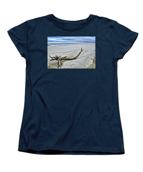 Women's T-Shirt (Standard Cut) featuring the photograph Driftwood On The Beach by Paul Ward