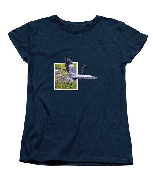 Great Blue Heron Takes Flight Women's T-Shirt (Standard Cut) by Roger Wedegis