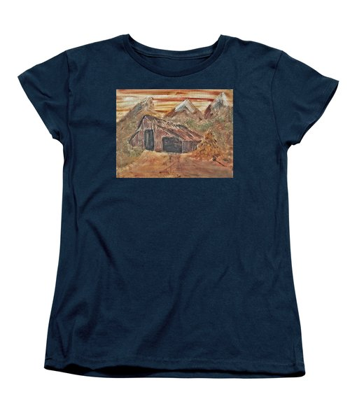 Women's T-Shirt (Standard Cut) featuring the painting Old Farmhouse With Hay Stack In A Snow Capped Mountain Range With Tractor Tracks Gouged In The Soft  by MendyZ