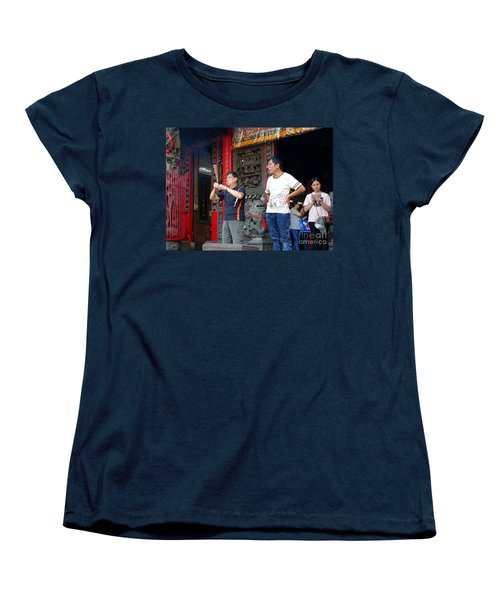 Women's T-Shirt (Standard Cut) featuring the photograph Praying At A Temple In Taiwan by Yali Shi