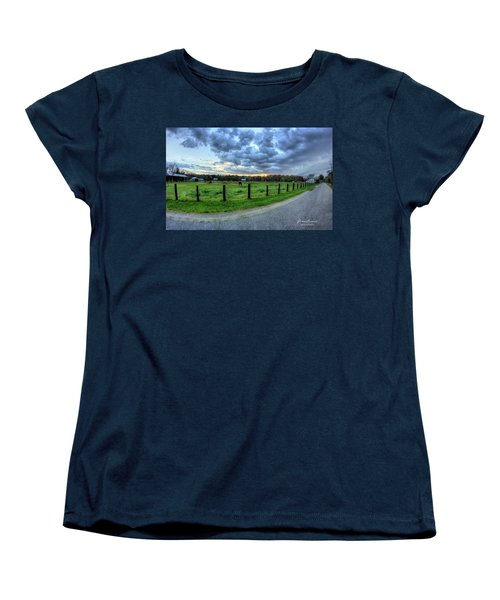 Storm Clouds Over Main Street Women's T-Shirt (Standard Cut) by John Loreaux