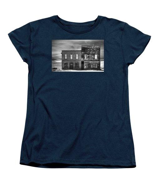 The Boot Building Women's T-Shirt (Standard Cut) by Marius Sipa