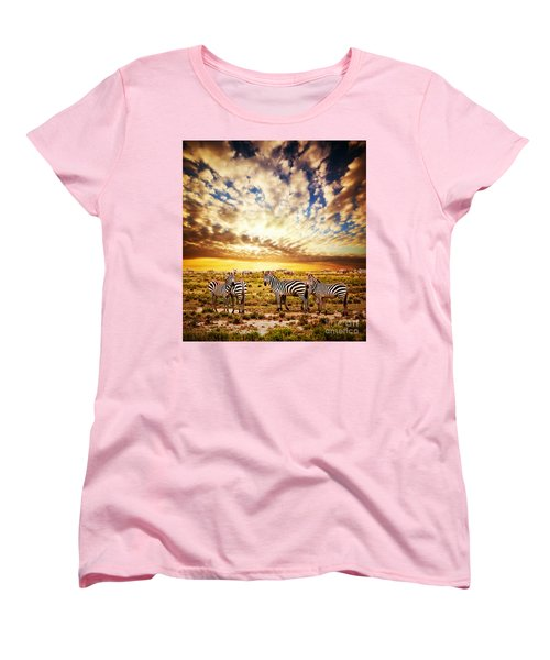 Zebras Herd On African Savanna At Sunset. Women's T-Shirt (Standard Cut) by Michal Bednarek