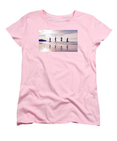 Girls Jumping On Lofoten Beach Women's T-Shirt (Standard Cut) by Tamara Sushko