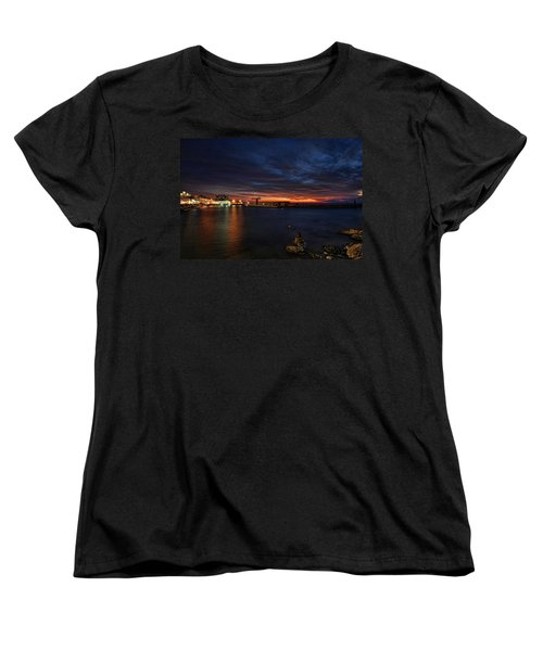 Women's T-Shirt (Standard Cut) featuring the photograph a flaming sunset at Tel Aviv port by Ron Shoshani
