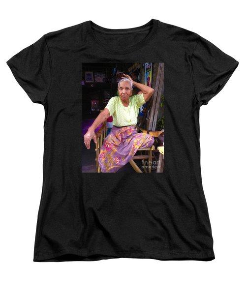 Women's T-Shirt (Standard Cut) featuring the photograph Portrait Of Elderly Burmese Lady Sitting In Front Of Home 33rd Street Chanayethazan Mandalay Burma by Ralph A  Ledergerber-Photography