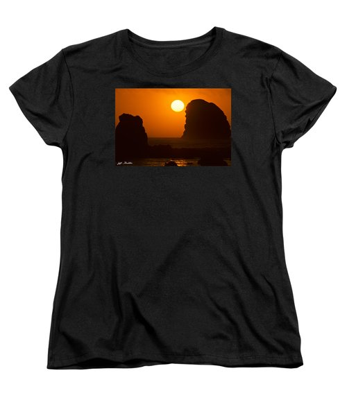Women's T-Shirt (Standard Cut) featuring the photograph Sunset Over The Pacific Ocean With Rock Stacks by Jeff Goulden