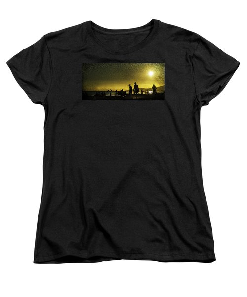 Women's T-Shirt (Standard Cut) featuring the photograph Sunset Silhouette Of People At The Beach by Peter v Quenter