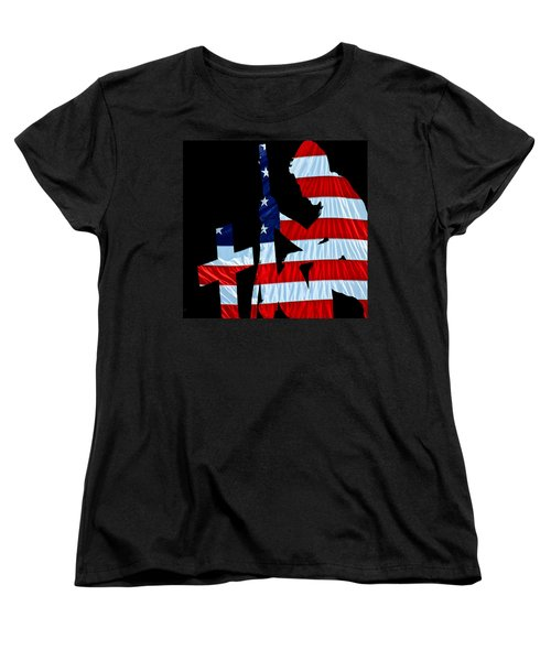 A Time To Remember United States Flag With Kneeling Soldier Silhouette Women's T-Shirt (Standard Cut) by Bob Orsillo