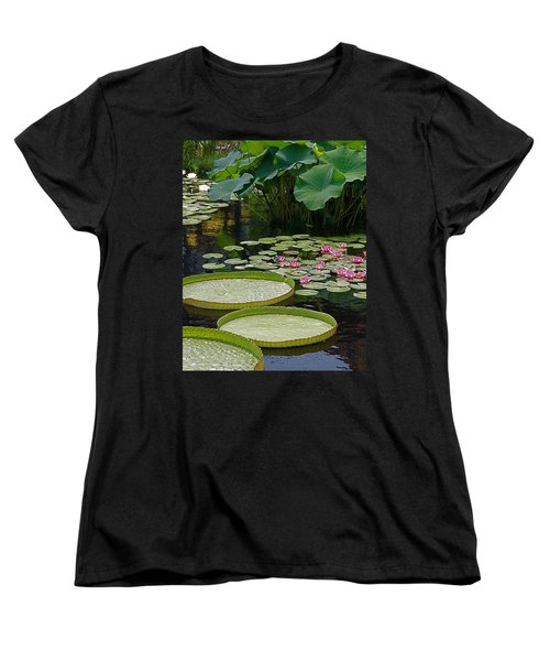 Women's T-Shirt (Standard Cut) featuring the photograph Water Lilies And Platters And Lotus Leaves by Byron Varvarigos