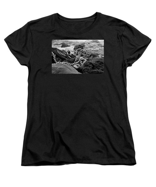 Women's T-Shirt (Standard Cut) featuring the photograph Fisherman Sleeping On A Huge Array Of Nets by Tom Wurl