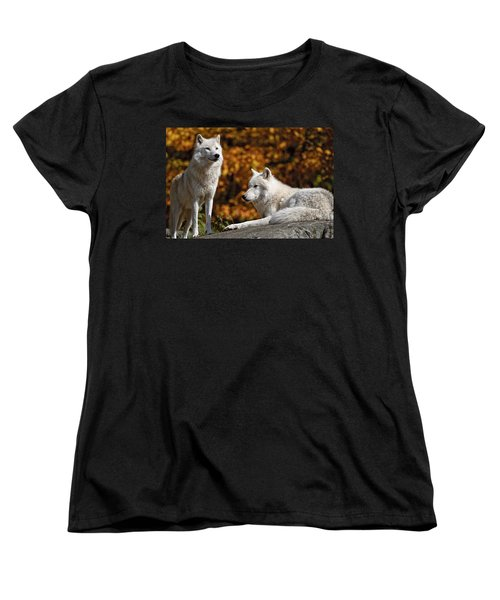 Women's T-Shirt (Standard Cut) featuring the photograph Arctic Wolves On Rocks by Michael Cummings