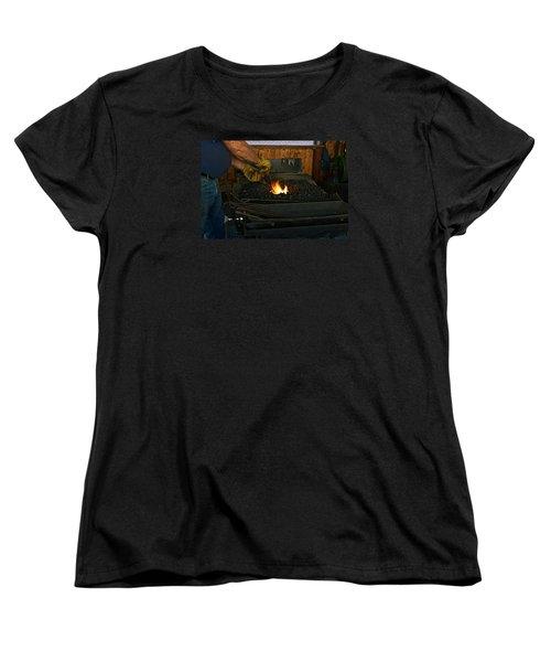 Blacksmith At Work Women's T-Shirt (Standard Cut) by Steven Clipperton