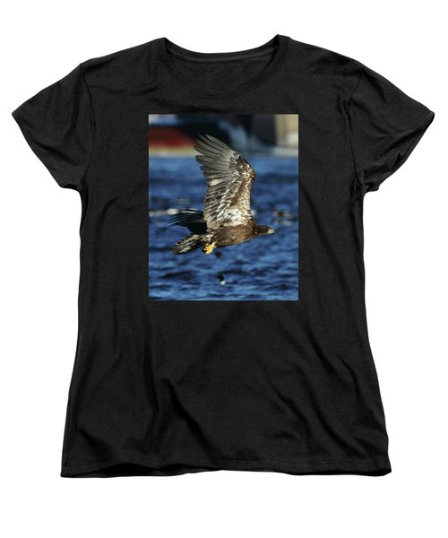 Women's T-Shirt (Standard Cut) featuring the photograph Juvenile Bald Eagle Over Water by Coby Cooper